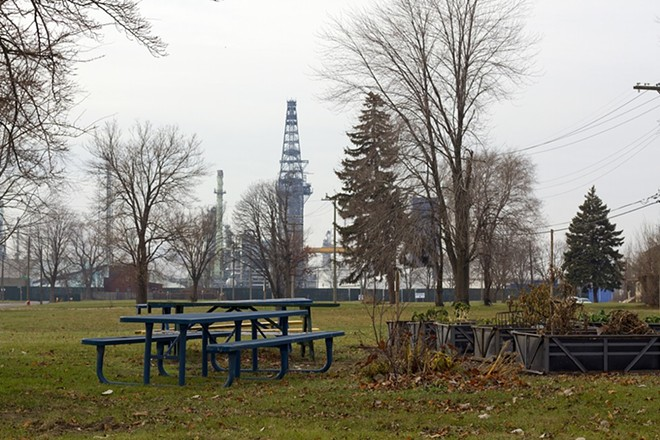 A park in the shadow of Marathon's oil refinery in southwest Detroit. - STEVE NEAVLING