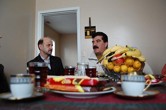 Samir Alrashdan, right, and landlord Bashar Imam in Hamtramck. - DON JORDAN