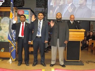 Left to right: Abu Musa, Saad Almasmari, and Anam Miah are sworn in by Judge Paul J. Paruk.