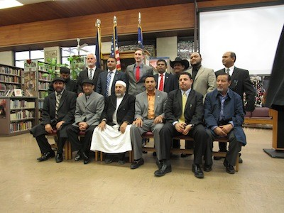 For five minutes, Hamtramck's politicos would take a picture with anybody who joined them.