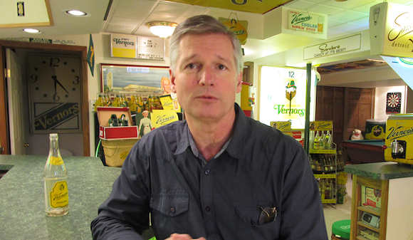 Keith Wunderlich sits at the soda fountain in the small museum he's built in his basement.