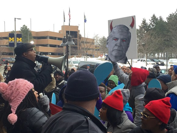 """Protesters chant """"raise the wage, clean our water"""" and """"you want our vote? Come get our vote!"""" outside the press area at Sunday's Democratic presidential debate in Flint. - PHOTO BY DUSTIN BLITCHOK"""