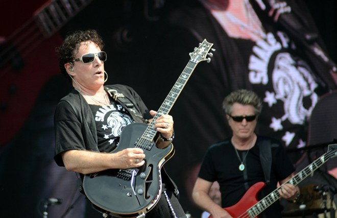 Streetlight people: Journey's Neal Schon and Ross Valory, somewhere in the night. - BRUCE ALAN BENNETT