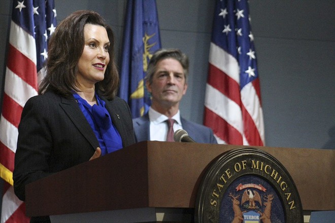 Gov. Gretchen Whitmer and Gerry Anderson, executive chairman of DTE, at a press conference Monday. - STATE OF MICHIGAN