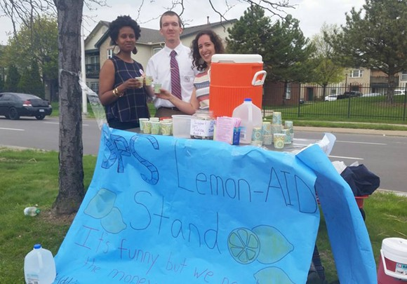 """Michigan legislators have refused to audit the finances of DPS. We set up a lemonade stand to help them fundraise. Now what's the excuse?"" says DPS teacher Nina Chacker, right, who stands with fellow DPS teachers Zack Sweet and Kiarra Ambrose."