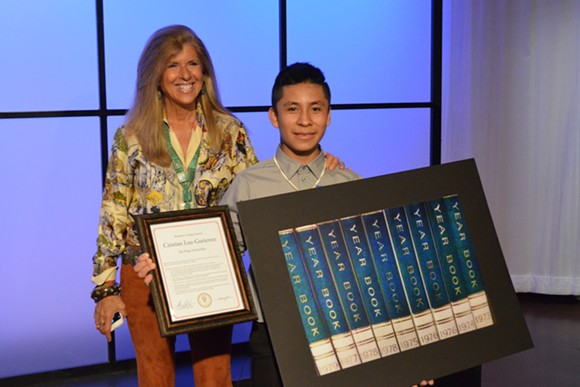 Pictures of Hope founder Linda Solomon with 13-year-old Cesar Chavez MIddle School student Cristian Luz-Gutierrez during a reception Thursday at WXYZ-TV. - PHOTO BY DUSTIN BLITCHOK.