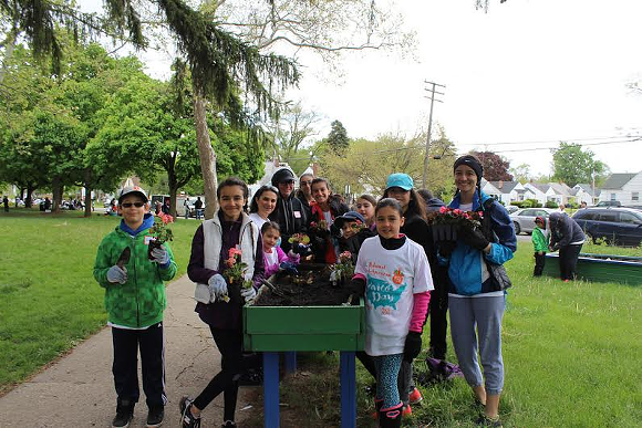 Volunteers plant flowers for community garden. - PHOTO CREDIT: NATIONAL NETWORK FOR ARAB AMERICAN COMMUNITIES