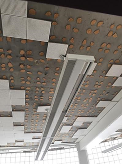 Ceiling in the Detroit Institute of Technology with missing tiles before renovation. - PHOTO CREDIT: NATIONAL NETWORK OF ARAB COMMUNITIES
