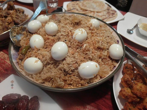 Biryani, loaded with chicken quarters, pineapple, and topped with hard boiled eggs. - PHOTO BY SERENA MARIA DANIELS