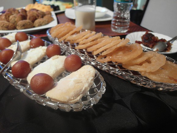 The platter to the left features gulab jammun balls and chomchom. To the right, the popular jalebi pastry. - PHOTO BY SERENA MARIA DANIELS