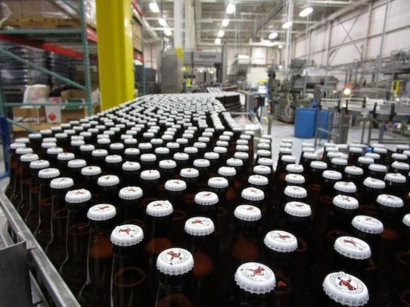 Bottling line inside Brew Detroit's facility. - PHOTO BY MICHAEL JACKMAN