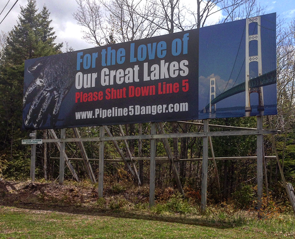 Billboards demanding the shutdown of Line 5 appeal to motorists on both sides of the Mackinac Bridge. - PHOTO BY LEE DEVITO