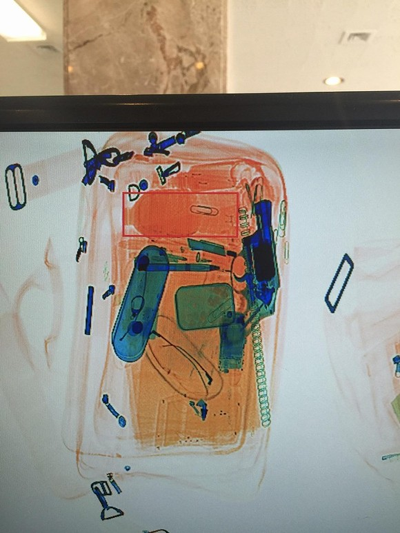 An X-ray image of a bag that slipped into City Hall on Monday with a handgun inside. - PHOTO COURTESY OF THE DETROIT POLICE DEPARTMENT