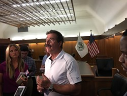 Grosse Pointe Farms Public Safety Director Daniel Jensen speaks to reporters at Municipal Court on Tuesday. - PHOTO BY RYAN FELTON