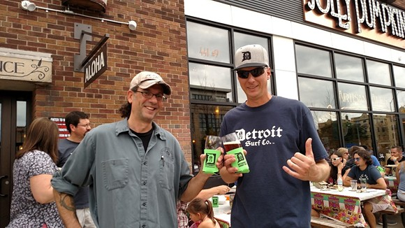 Ron Jeffries, Jolly Pumpkin Artisan Ales founder and brewmaster, and Dave Tuzinowski, owner of Detroit Surf Co., raise a glass of Detroit Surf Co. Pale Ale raise a glass of special collaborative brew Detroit Surf Co. Pale Ale.