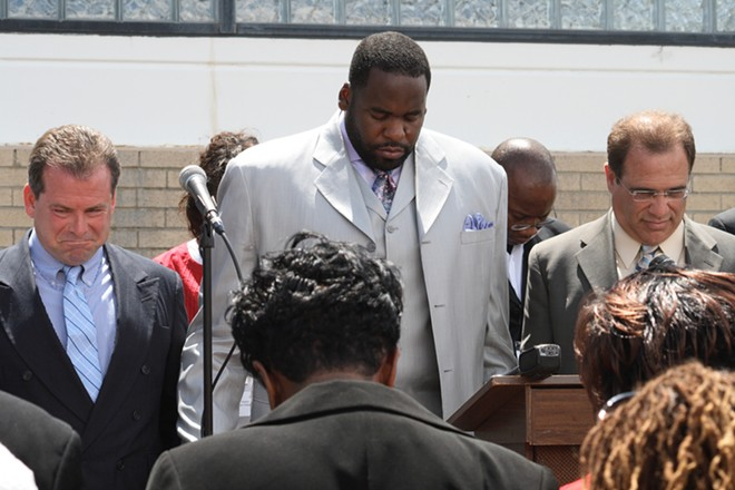 Kwame Kilpatrick and other officials at a public prayer rally. - SHUTTERSTOCK.COM