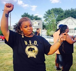 Mikera Manning, 34, holds up strands of hair she says police pulled out during her arrest June 7. - PHOTO BY ALLIE GROSS