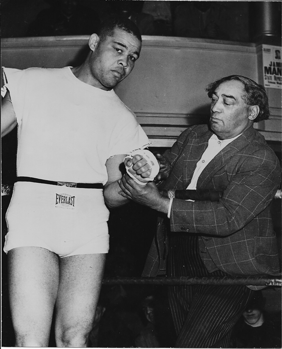 "Joe Louis, left, and the intriguing Henry Johnson, right. Referred to in Maraniss' account as ""Pappa Dee,"" a driver, Johnson was a hustler in the black community who ran a barbershop and ""managed"" boxers. - ILLUSTRATION FROM 'ONCE IN A GREAT CITY'"
