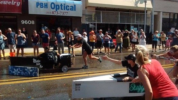 The front of the Whiskey's canoe is blocked by a goal marker, providing just enough drag to almost give Suzy's the win. - PHOTOS BY MICHAEL JACKMAN