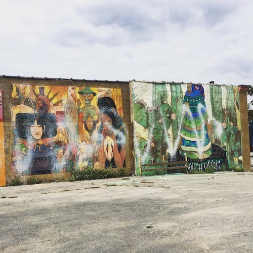 The mural was apparently defaced with white spray paint. - PHOTO TAKEN FROM LEE DEVITO'S FACEBOOK PAGE