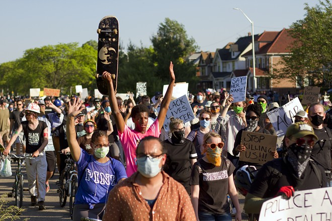Peaceful protesters marched on Gratiot on Tuesday before 127 of them were arrested. - STEVE NEAVLING