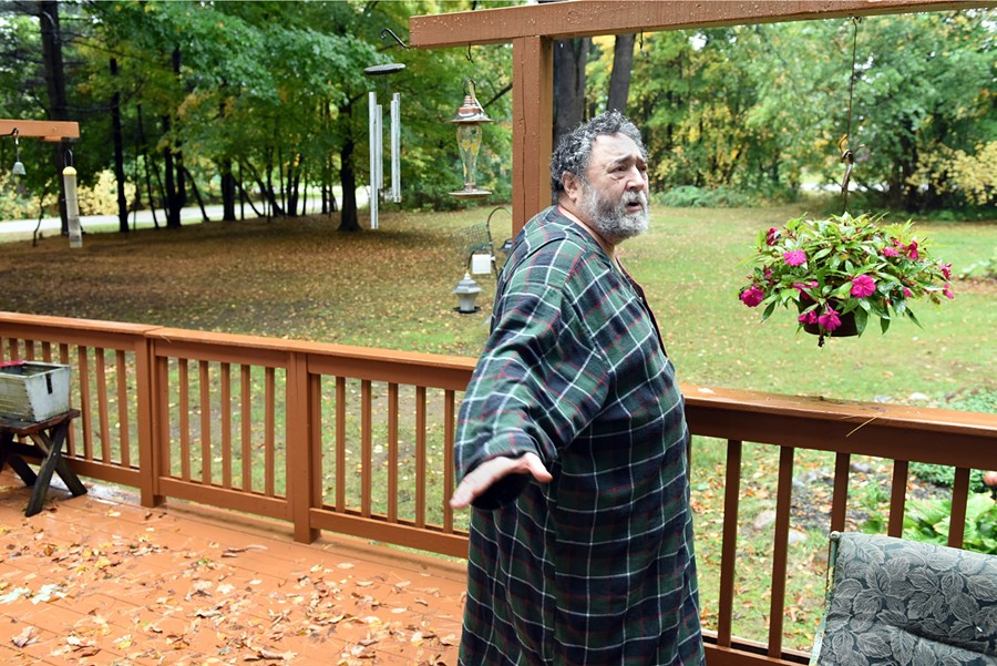 """Joel Selman on the deck of his Southfield home. He was convicted in May on a delivery and manufacture of marijuana charge in a case that began in 2010. """"I was in a wheelchair at sentencing,"""" Selman says. - PHOTO BY VAUGHN GURGANIAN"""