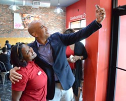 U.S. Sen. Cory Booker takes a selfie Thursday with Shantell Beckton, a manager at Kuzzo's Chicken & Waffles in Detroit. - PHOTO BY DUSTIN BLITCHOK