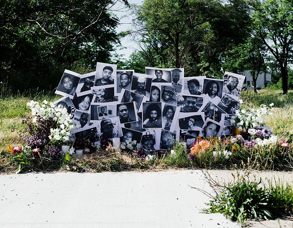Lisa Waud's latest floral installation, located at the intersection where Malice Green was killed by Detroit Police in 1992, honors other Black people who were slain. The installation is up until the end of the day on Saturday. - EE BERGER