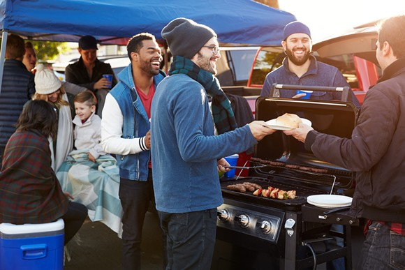 Some bros tailgating. - SHUTTERSTOCK