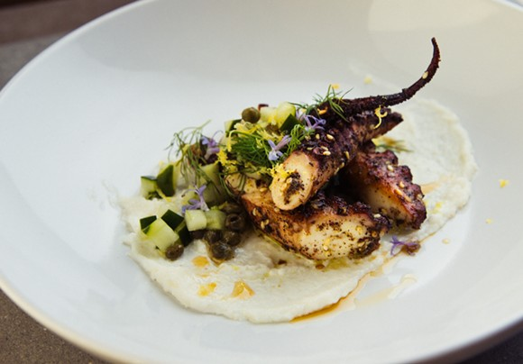 Za'atar-rubbed octopus with garlic, cucumber, and fresh herbs. - PHOTO BY JANNA COUMOUNDOUROS, LILACPOP STUDIO