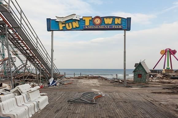 """Pier Entrance, Fun Town Amusements, Destroyed by Hurricane Sandy, Seaside Park, New Jersey, 2013. Elevation Sixteen Feet. N 39.94122 W 74.07093."" - PHOTO BY JOHN GANIS."