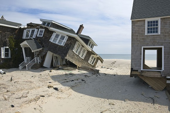 """""""Beach Houses after Hurricane Sandy, 959 East Avenue, Mantoloking, New Jersey, March 2013. Elevation Nine Feet. N 40.05418 W 74.04623."""" - PHOTO BY JOHN GANIS."""