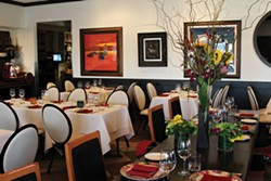 The upscale dining room at Bacco, where they put a fine-dining finish on Italian cuisine. - PHOTO BY SARAH RAHAL.