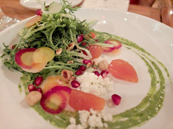 The winter persimmon salad, with frisee, fuyu persimmon, pomegranate, hazelnut, buttermilk cheese, and green goddess dressing. - PHOTO BY SERENA MARIA DANIELS