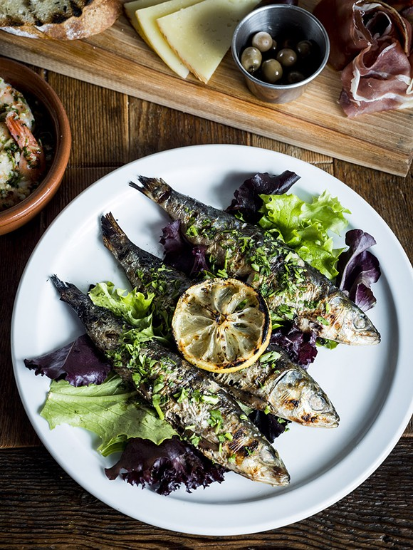 Sardinas Asadas – grilled fresh sardines, with grilled lemon, and tarragon at La Feria in the Cass Corridor. - © JOE VAUGHN