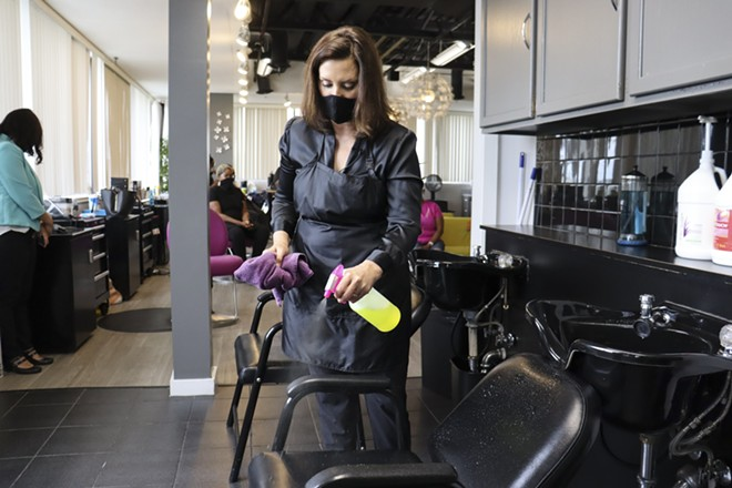 Gov. Gretchen Whitmer at Reflections Hair Salon in Grand Rapids, where she helped clean equipment. - STATE OF MICHIGAN