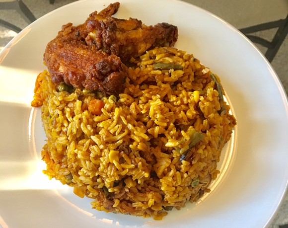 IN this fusion fare, all-American fried chicken cozies up to seasoned rice. - PHOTO BY AMENEH MARHABA