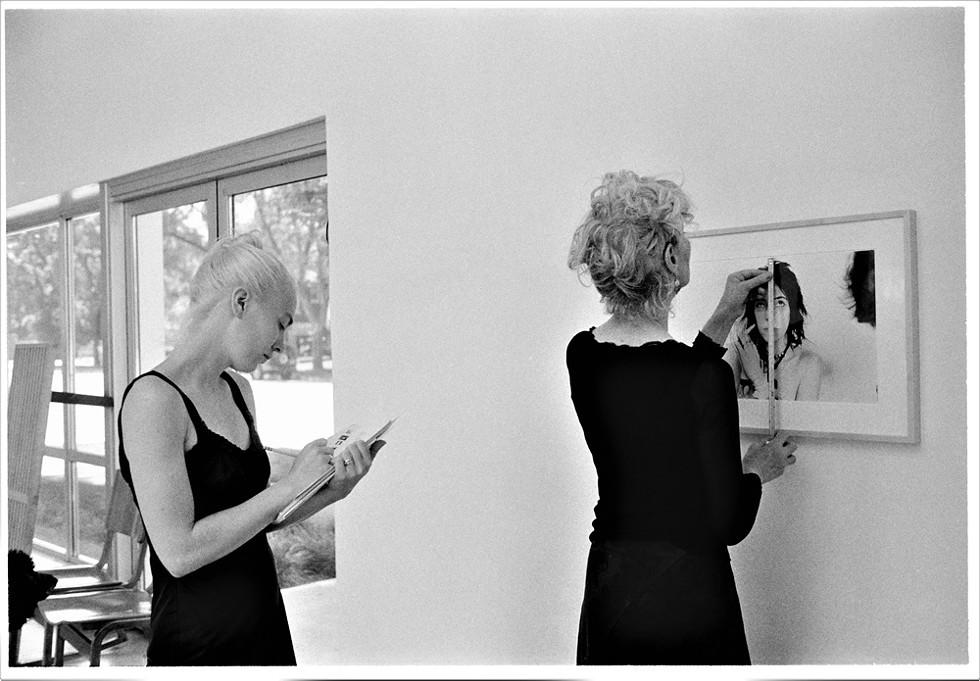 Gallery director Hazel Blake (at left) installs an exhibition by artist Judy Linn with Susanne Hilberry (right), 2008. - JUDY LINN