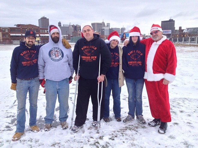 The Navin Field Grounds Crew at the abandoned Tiger Stadium site in Corktown on Christmas Day 2012. Joe Michnuk is at far right in his Santa suit. - BRUCE GIFFIN