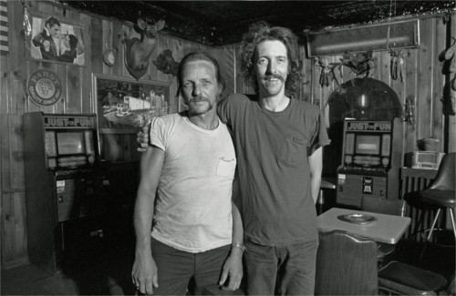 "This photo, titled ""Buddies,"" shows two friends hanging out at the Buckhorn Inn. Harkness says, ""The Buckhorn Inn stood for years on the corner of Ferry St. and Dubois. It burned down around 1990. It was situated just west of the still extant but abandoned Chene-Ferry Market. The owner was Walter Miller."" - PHOTO COURTESY BRUCE HARKNESS"