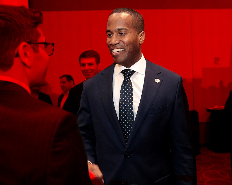 """Republican Senate candidate John James says his company """"added 100 jobs in Michigan and east of the Mississippi"""" under his leadership. Documents show the company lost its tax exempt status after it failed to create the jobs it promised — all while James lined his pockets. - REUTERS/REBECCA COOK"""
