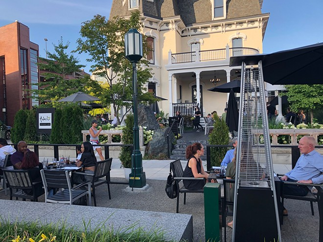 Adachi's patio on a recent weekday evening in Birmingham. - LEE DEVITO