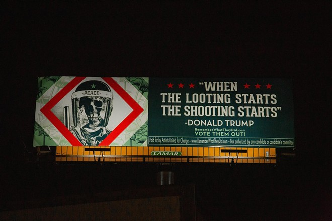 Shepard Fairey's billboard addressing President Trump's violent rhetoric. - CASEY CHAMBERLAIN