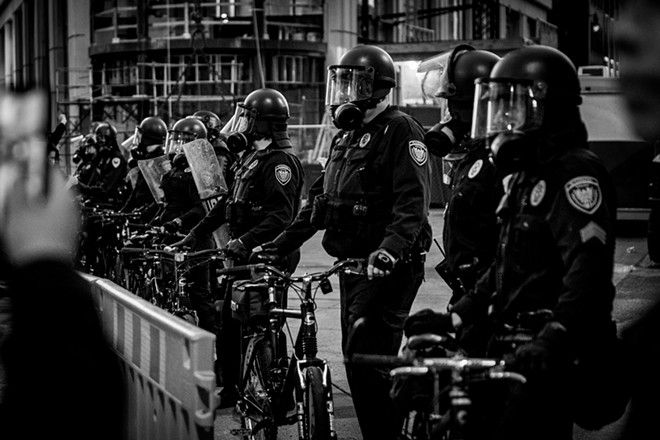 Grand Rapids police during the May 30 protest. - JARED BOONE, SHUTTERSTOCK.COM