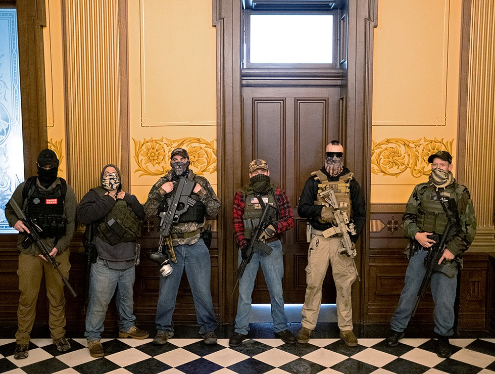 Protesters occupied the Michigan state capitol building on April 30, 2020. Three men were later identified by a Washington Post analysis as (from right) Pete Musico, Paul Bellar, and Joseph Morrison. - REUTERS/SETH HERALD