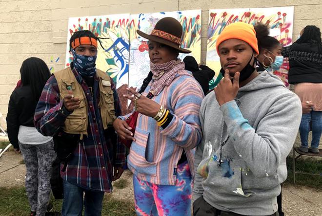 From left to right: artist Escada (dark lord), Konstance Patton, owner of Konartstudio, and artist Cameron Jenkins. - DEV
