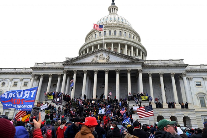 Mob of Trump supporters outside the Capitol building on Wednesday. - SHUTTERSTOCK