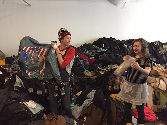 Russell tenant Kory Trinks begins the process of packing up thousands of pounds of vintage wares. - VIOLET IKONOMOVA