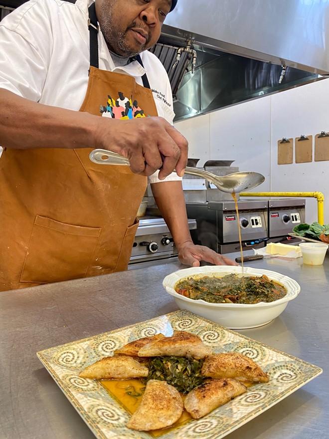 "Jones puts the finishing touches on his dish, the ""Black Bottom and Poletown Sweet Potato Pierogi."" - COURTESY PHOTO"
