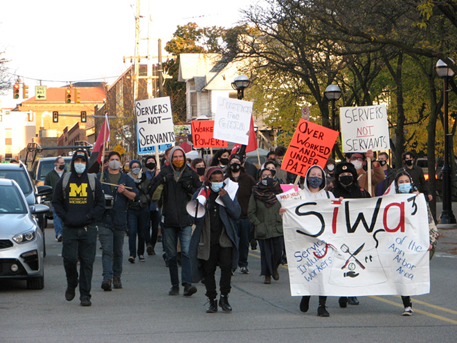 Members of the Service Industry Workers of the Ann Arbor Area (SIWA3) march in October. - ELISE BREHOB